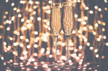 Champagne glasses toasting end of year quotes